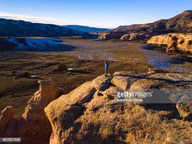hiker on red rock canyon ridge  along colorado river - fruita colorado stock pictures, royalty-free photos & images