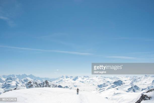 hiker on snowy mountain summit - snowcapped mountain stock pictures, royalty-free photos & images