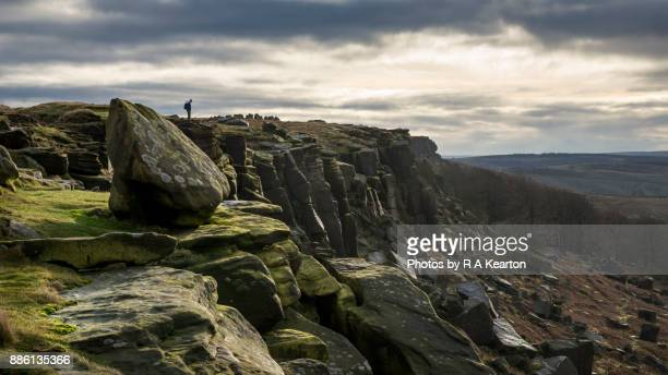 hiker on stanage edge, peak district, derbyshire - escarpment stock pictures, royalty-free photos & images