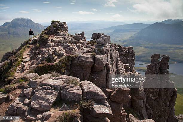Hiker on summit ridge of Stac Polliadh, Scotland