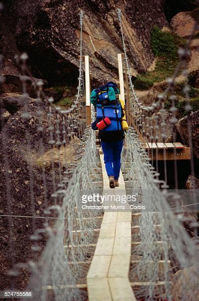 Hiker on Swinging Bridge