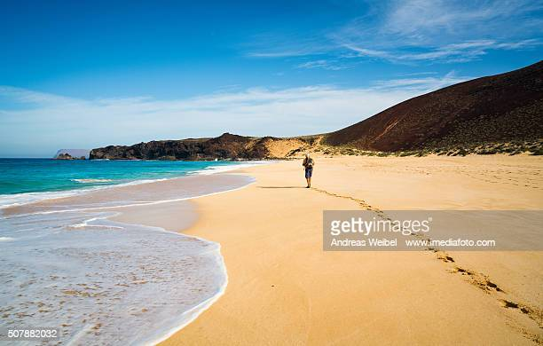 Hiker on the beach of Las Conchas