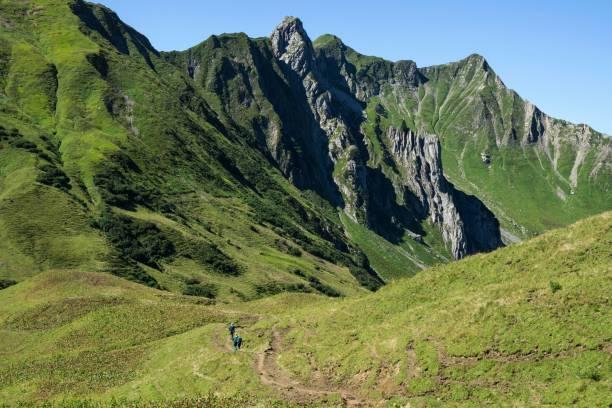 Hiker on the Hochalp Pass, behind Weisser Schrofen, near Baad, Kleinwalsertal, Allgaeu Alps, Allgaeu, Vorarlberg, Austria