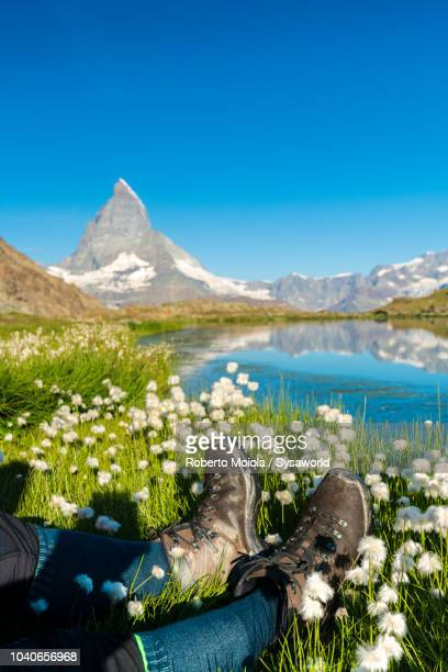 hiker on the shore of riffelsee, switzerland - zermatt stock pictures, royalty-free photos & images