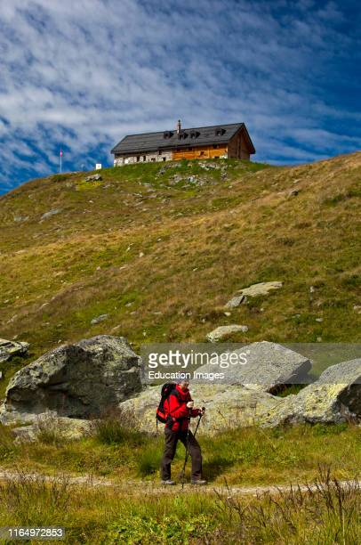 Hiker on the way to the mountain hut Cabane du Mont Fort of the Swiss Alpine Club SAC, Verbier, Valais, Switzerland.