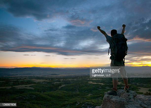 hiker on top of mountain at sunset - castle rock colorado stock pictures, royalty-free photos & images