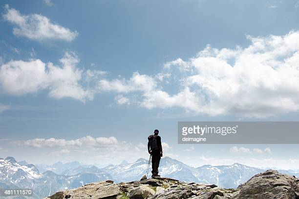 hiker on top of mountain - mountain peak stock pictures, royalty-free photos & images