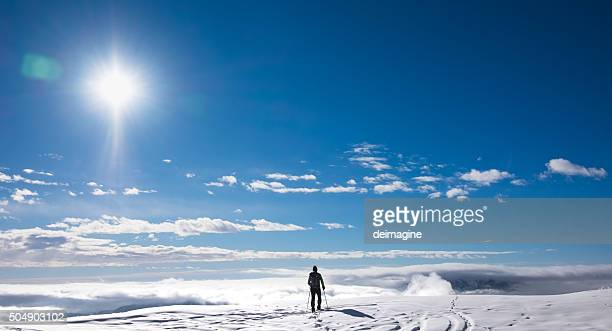 Hiker on top of snowy mountain
