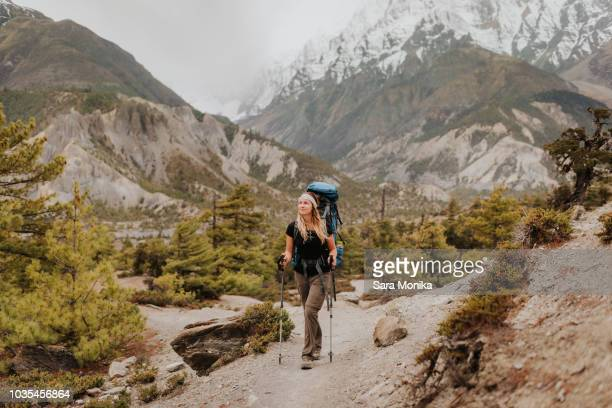 Hiker on trail, Annapurna Circuit, the Himalayas, Manang, Nepal