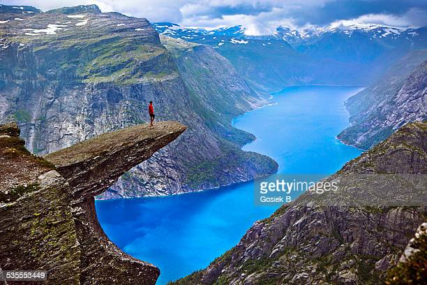 hiker on trolltunga - norway stock pictures, royalty-free photos & images