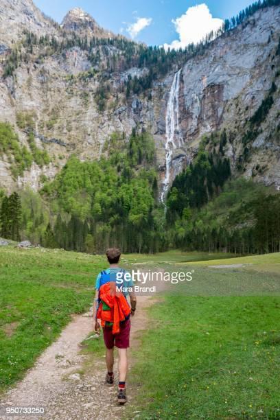 Hiker on way to Roethbach Waterfall, highest waterfall in Germany, Salet am Koenigssee, National Park Berchtesgaden, Berchtesgadener Land, Upper Bavaria, Bavaria, Germany
