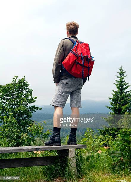 Hiker overlooking mountains and taking in the view