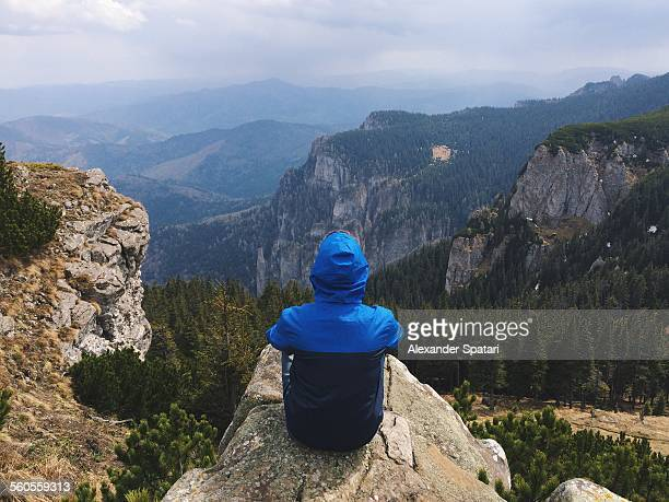 Hiker overlooking mountains in Ceahlau, Romania