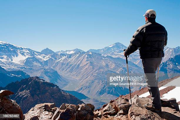 Hiker overlooking snowy mountains