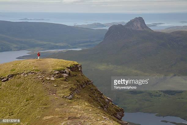 Hiker overlooking Stac Polliadh, Scotland