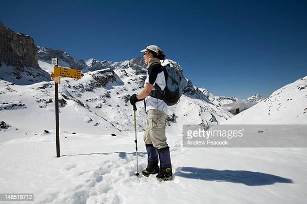 Hiker pauses at Col des Essets on 'Tour of L'Argentine' trek.