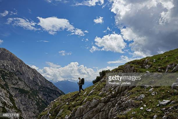 Hiker pictured on his way to the 'Lamsenspitze' at the Karwendel region on June 13, 2014 near Vomp, Austria. The Karwendel is the largest range of...