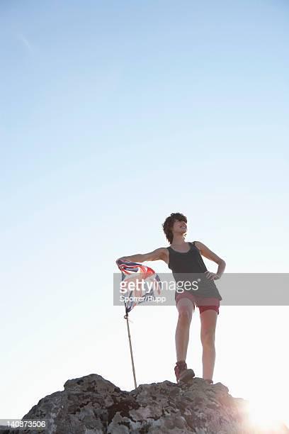 Hiker planting Union Jack flag