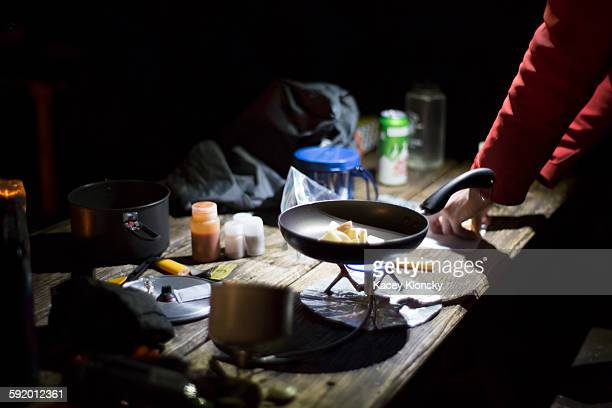 Hiker preparing dinner at camp