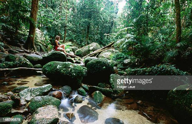 Hiker relaxing at Mossman Gorge, Daintree National Park.