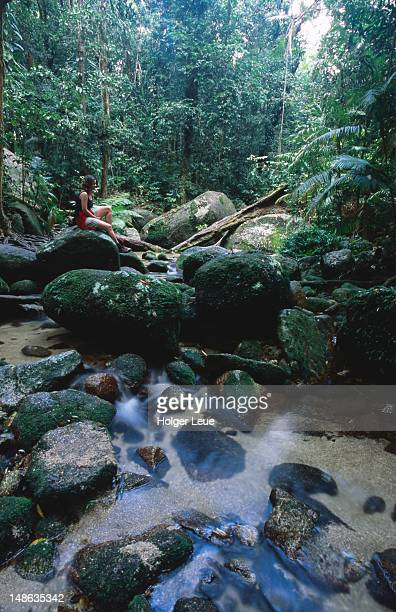 Hiker relaxing at Mossman Gorge.