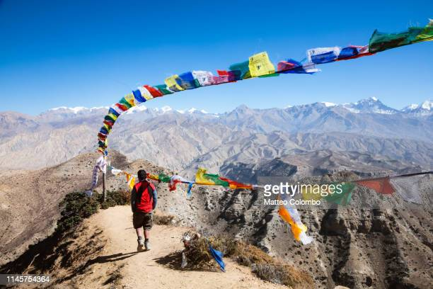 hiker relaxing on mountain high pass, upper mustang, nepal - annapurna conservation area stock photos and pictures