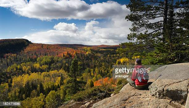 hiker resting and taking in an autumn view. - minnesota bildbanksfoton och bilder