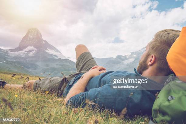 hiker resting in meadow, matterhorn view - swiss culture stock pictures, royalty-free photos & images