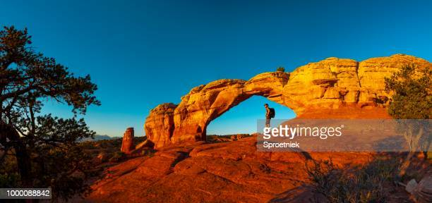 hiker resting in turret arch - national park stock pictures, royalty-free photos & images