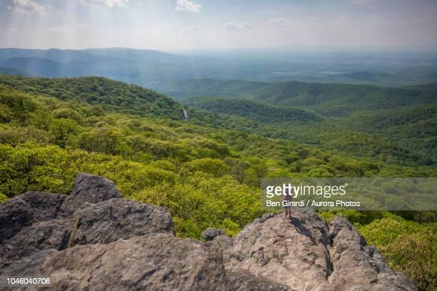 Hiker standing at edge of Humpback Rock, Virginia, United States