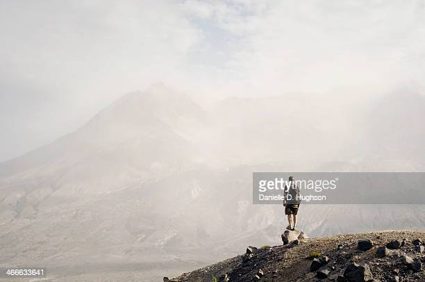 hiker standing in front of mout st. helens - mount st. helens ストックフォトと画像