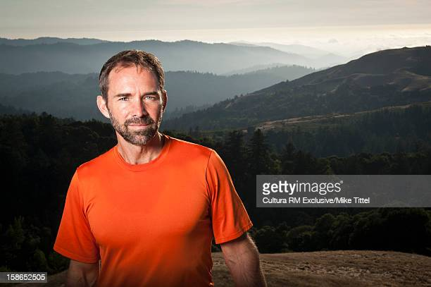 Hiker standing on hilltop