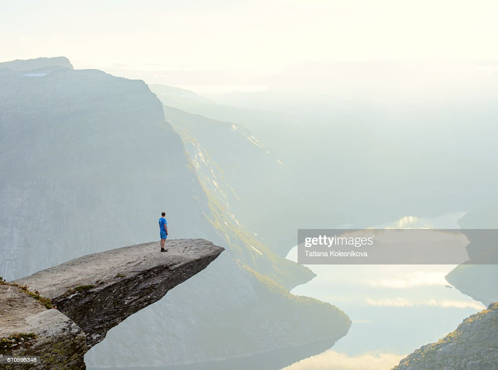 Hiker standing on Trolltunga : Stock Photo