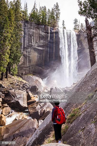 Hiker stands near Vernal falls, Yosemite National Park, California