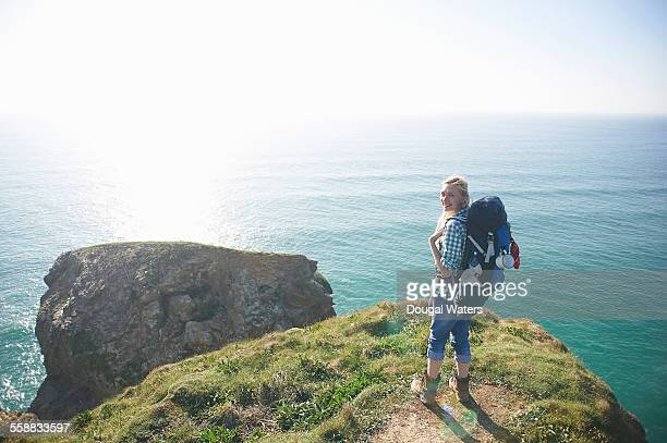 A hiker stands on an Atlantic cliff top