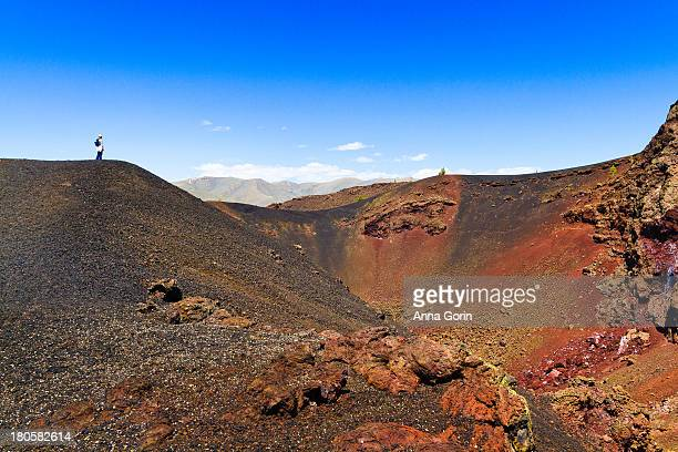 hiker stands on hill at craters of the moon, idaho - big bottom stock pictures, royalty-free photos & images