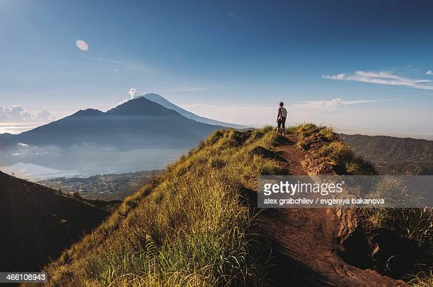 Hiker staying on top of  Mount Batur