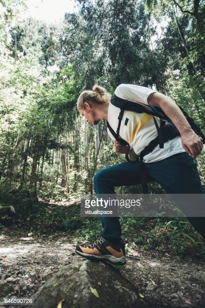 Hiker Stepping on a Stone