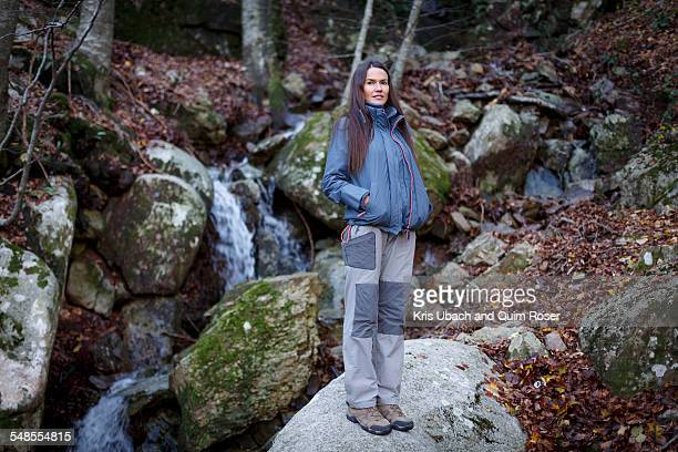 Hiker taking break by stream, Montseny, Barcelona, Catalonia, Spain