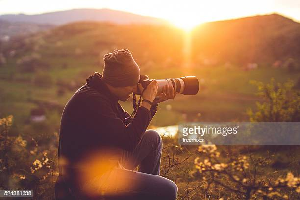 hiker taking photos - photographer stock photos and pictures