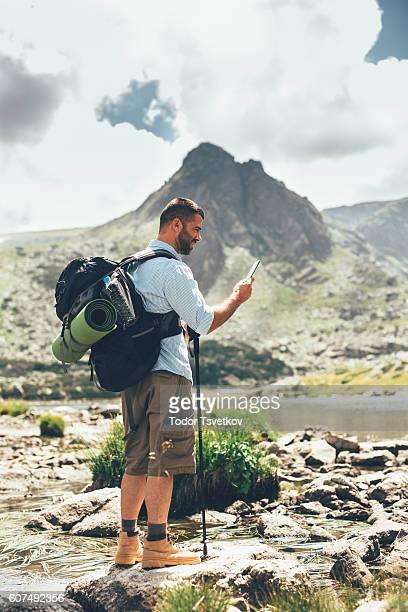 Hiker using a smart phone