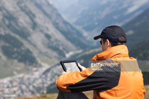 Hiker Using Digital Tablet in the Mountains