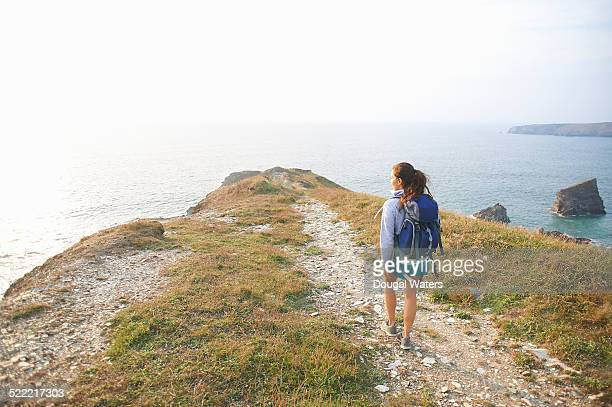 Hiker walking along Atlantic coastal path.