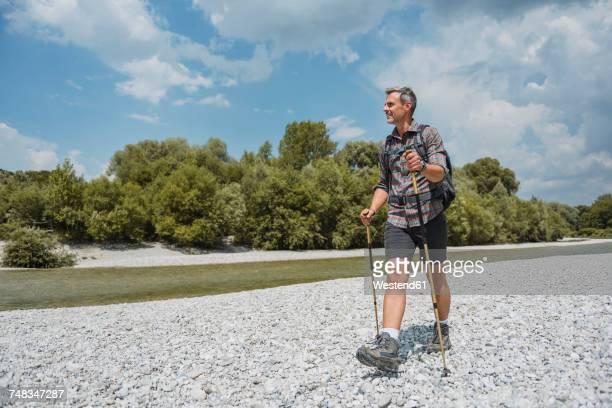 Hiker walking at the riverbank