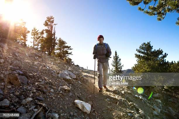 Hiker walking Cucamonga Peak, Mount Baldy, California, USA