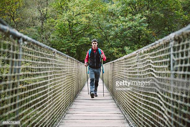 hiker walking on a bridge in nature - approaching stock pictures, royalty-free photos & images