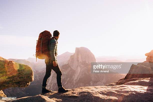 hiker walking on mountain path, yosemite, california, usa - yosemite nationalpark stock pictures, royalty-free photos & images