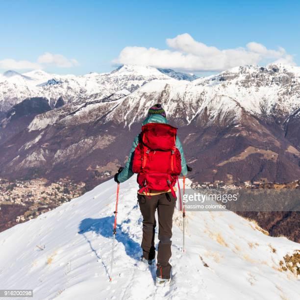 Hiker walking top snow mountain ridge