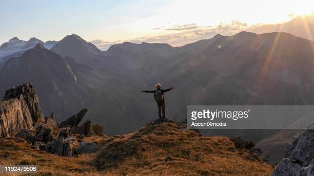 hiker walks along mountain ridge at sunrise - look back at early colour photography stock pictures, royalty-free photos & images