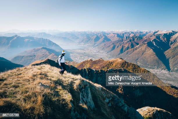 hiker walks final steps on mountain summit, valley - ticino canton stock pictures, royalty-free photos & images